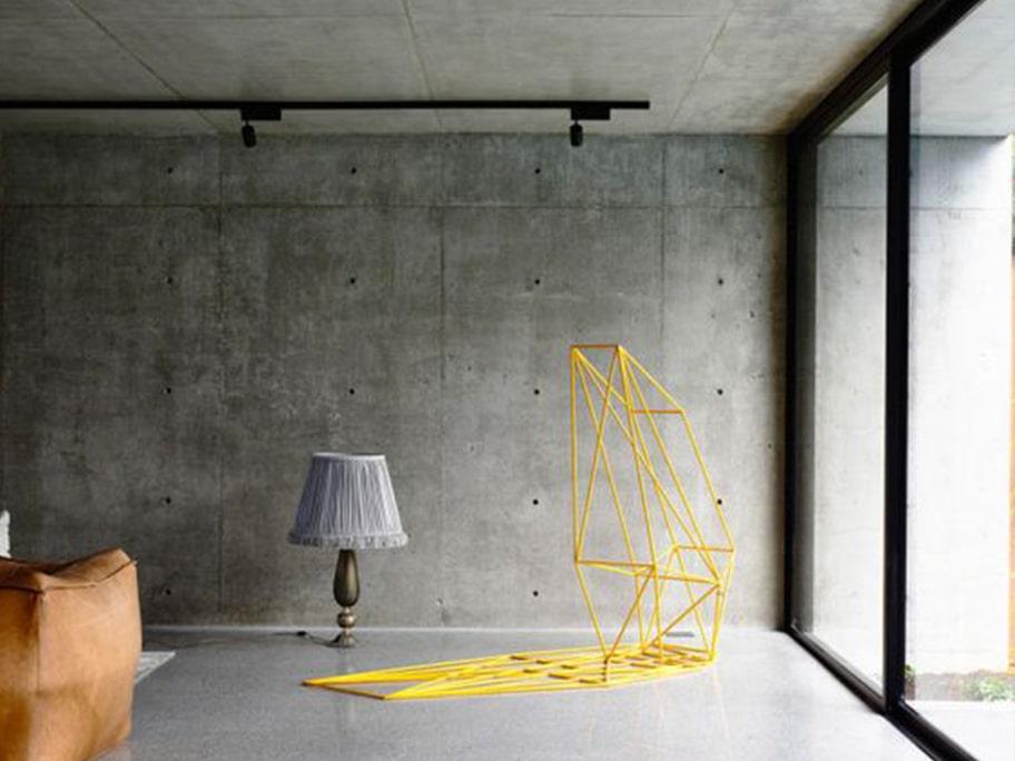 Giấy dán tường giả bê tông làm cho không gian sống thoáng rộng hơn